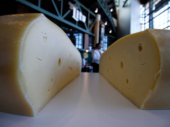 A freshly cut wheel of Swiss cheese sits at the U.S. Championship Cheese Contest in Green Bay, Wisconsin, in 2017.