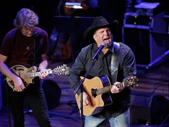 Garth Brooks and Sam Bush perform at the 54th Annual
