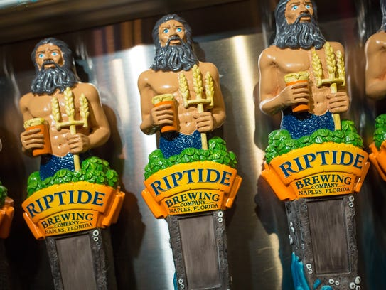 Beer taps bearing the Riptide Brewing Company logo