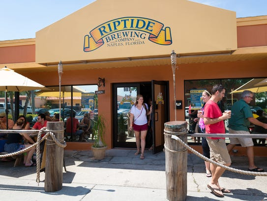 Patrons circulate at Riptide Brewing Company on July