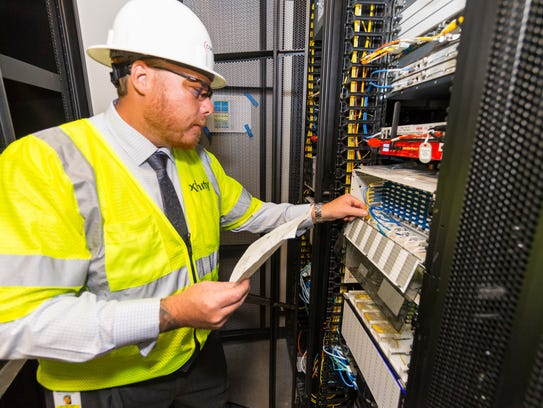 Michael Ferrie, Comcast project manager, checks equipment