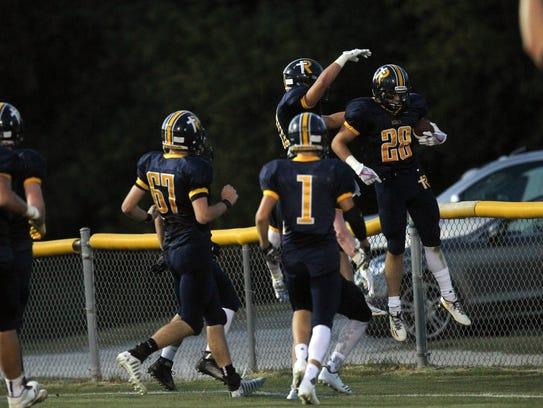 Regina's Ryan Schott celebrates his touchdown during