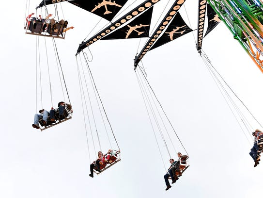 Fairgoers swing high in the air during the N.C. Mountain