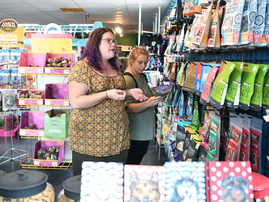 Jenna Wilson, owner of Patton Avenue Pet Company, helps