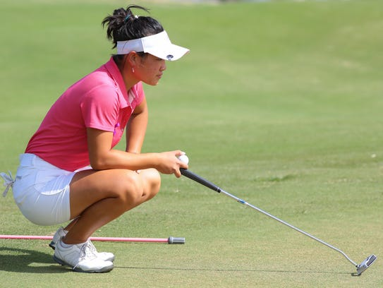 Madison Walker lines up a putt at the Desert Valley