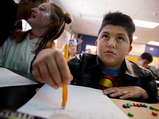 Bryan Castanon Gonzales works on a class project Tuesday at Hermosa Middle School in Farmington.