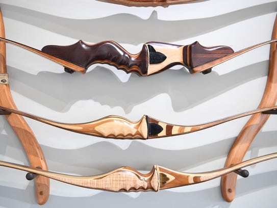 A set of elaborate wooden bows are on display in the