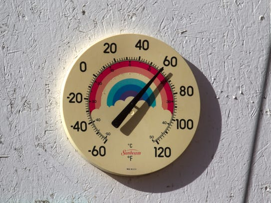An outdoor home temperature gauge reads 60 degrees on Tuesday morning at a home in Bloomfield.