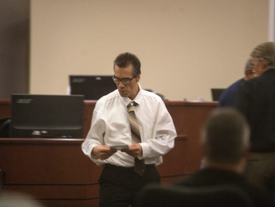 Rick Stallings prepares for his trial on Monday at the Aztec District Court.