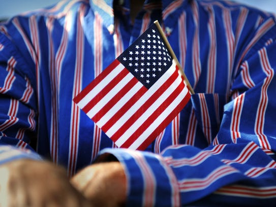 """The Treasure Coast Community Singers perform """"You're a Grand Old Flag"""" on Saturday and Sunday at the North Stuart Baptist Church."""