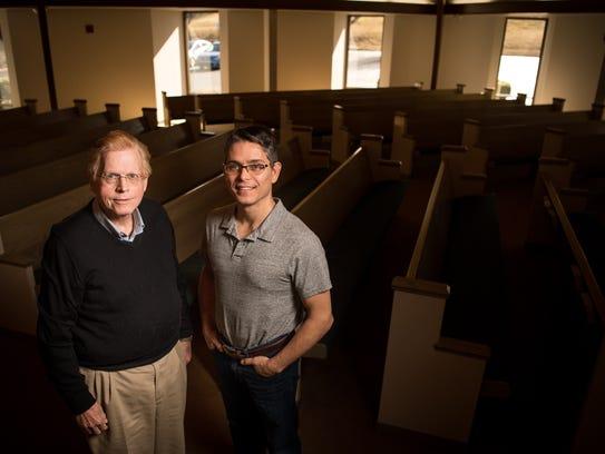 Richard Terry, left, and Preacher Mitch Davis, right,