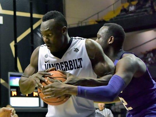 Vanderbilt center Djery Baptiste (12) battles to control