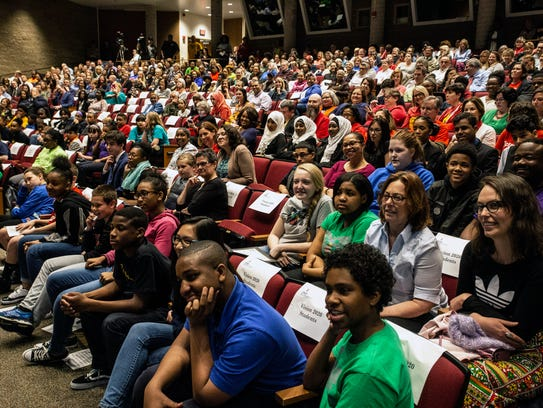 Students, teachers, and parents gathered in the Youth
