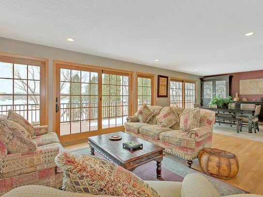 Large sliding doors to the riverfront deck grace the
