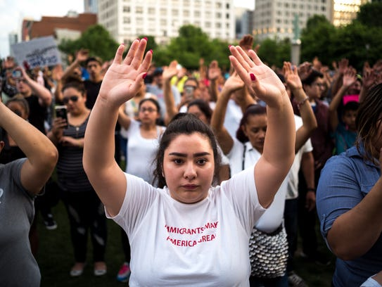 Bertha Rivas, center, of Nashville, holds her hand up during a protest against HB 2315, a bill that will ban sanctuary cities in Tennessee, at Public Square Park in Nashville, Tenn., Wednesday, May 16, 2018.