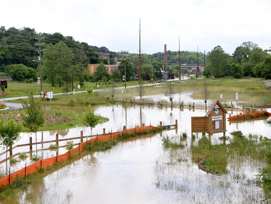 The French Broad River floods into the Craven Street