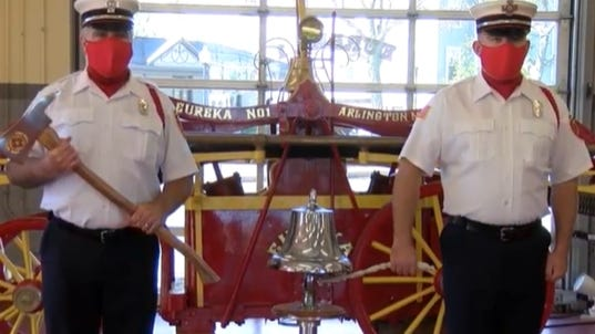 Members of the Arlington Fire Department ring the ceremonial bell 11 times, a tradition that dates back to the end of World War I, to honor veterans who have served. [Courtesy Image/Arlington Community Media] Inc.