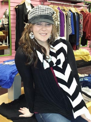 Sara Jacobson is moving her Fusion Boutique from Clive to West Des Moines.