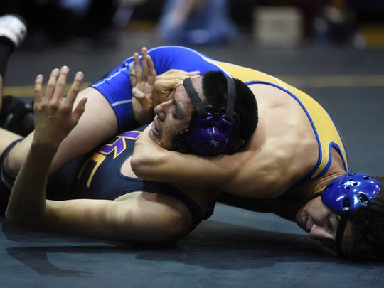 Bloomfield's Levi Whitley turns Kirtland Central's Brad Benally on his back in the Panther Classic on Saturday at the Jerry A. Conner Fieldhouse in Farmington.