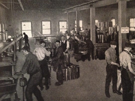 Workers in Binghamton assemble the new machines in 1920.