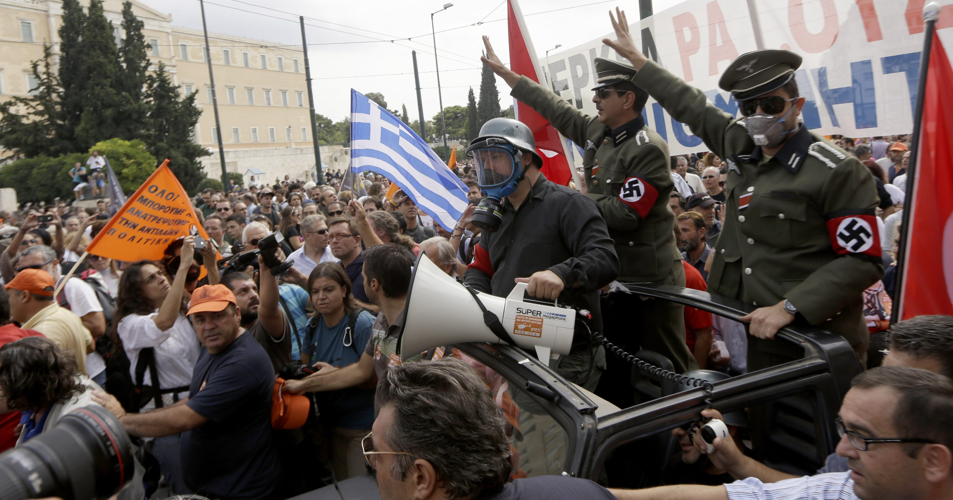 germany s merkel arrives to protests in greece