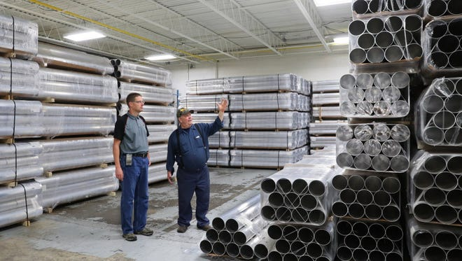 American Sewer Parts and Cleaning stockpiled aluminum this summer, hoping to guarantee inventories as metals prices began to fluctuate erratically in the wake of a 10 percent tariff on foreign aluminum imposed by the White House. Operations manager Mirk Buzdum (left) and owner Pete Utecht say their machine shop in Menomonee Falls is caught in the middle of a global trade war.