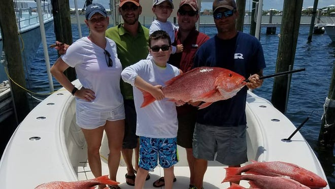 A crew of happy anglers after a day of red snapper fishing with Captain Chaz Heller of Got'm Fishing Charters out of Pensacola Beach.