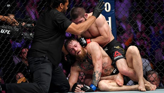 Chaos erupts after Khabib Nurmagomedov submits Conor McGregor in main event at UFC 229