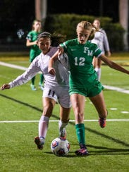 Fort Myers' Alyssa Wilson takes the ball from a Bishop