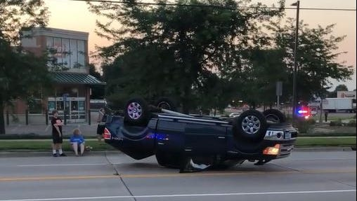 A truck rolled after running a red light at 26th Street and Sycamore Avenue early Wednesday morning.