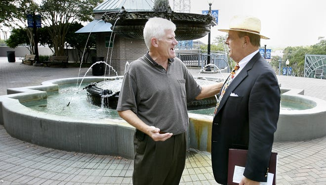 Dan Kleman, left, stops to talk with Ken VanAssenderp as he crosses the Kleman Plaza September 1, 2006.