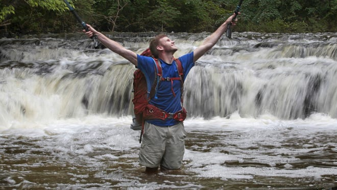 Tyler Socash, 28, puts in the miles at Corbett's Glen in Brighton Thursday, June 18, 2015. Socash quit his job at the University of Rochester and spent a year hiking 6,600 miles. He finished the final leg of his trek, on the Appalachian Trail, on July 26, 2016.
