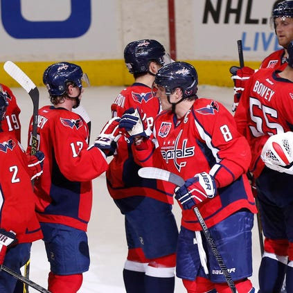 Sep 21, 2014; Washington, DC, USA; Washington Capitals players celebrate after their game against the Buffalo Sabres at Verizon Center. The Capitals won 1-0. Mandatory Credit: Geoff Burke-USA TODAY Sports