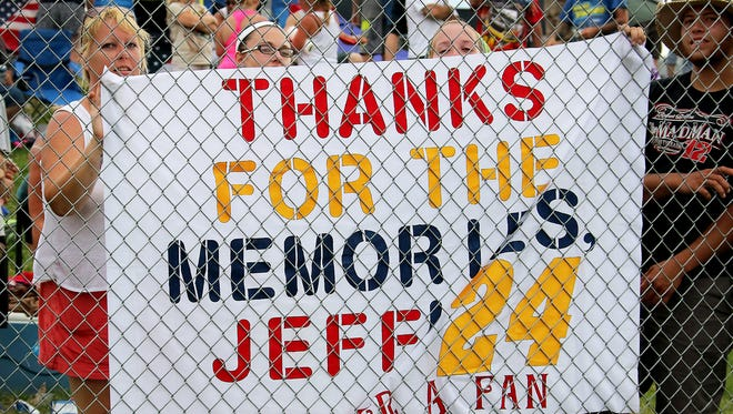 Fans of Jeff Gordon hold a sign at the Brickyard 400 in 2015.