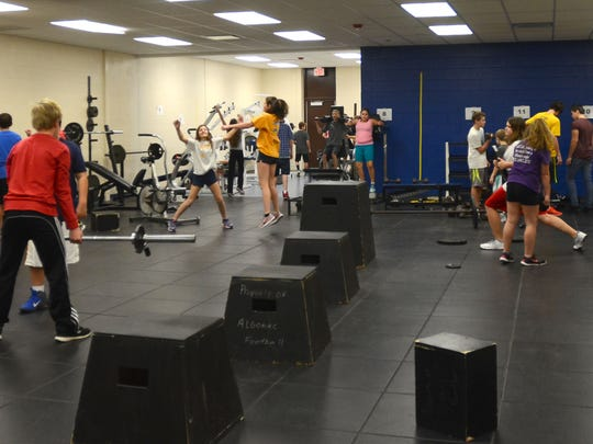 Seventh and eighth grade students workout in the Algonac Junior/Senior High School weight room Tuesday. The room was expanded when the middle school grades were moved to the high school this year.