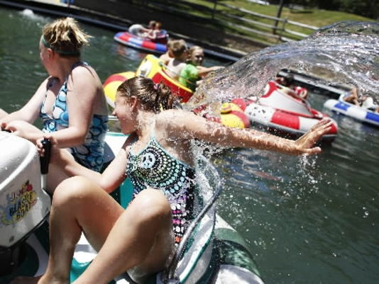 Erin McBrairty, 12 of Springettsbury Township, and Amelia Strayer, 11 of Springettsbury Township, are doused with water during Summer Adventure Camp at Roundtop Mountain Resort in 2011. (File photo)