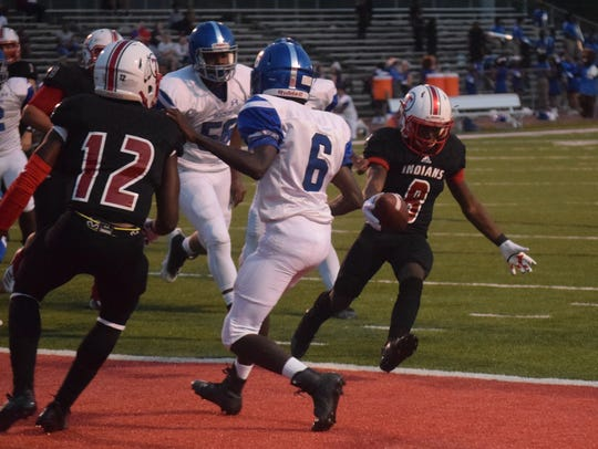 Tioga junior running back Antonio Logan (8) scores