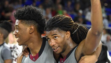 Josh Osborne (23) and Deshawn Johnson (11) celebrate Maplewood's 57-56 win over Haywood in the Class AA semifinals at Murphy Center in Murfreesboro on March 17, 2017.