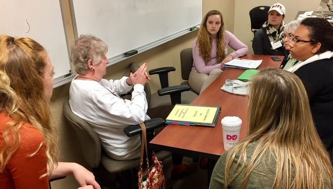 Students in a politics class at St. John Fisher College and residents of St. John's Home discuss presidential politics.