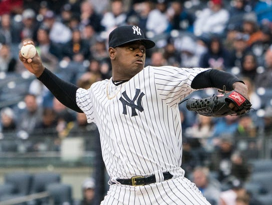 New York Yankees pitcher Luis Severino (40) delivers