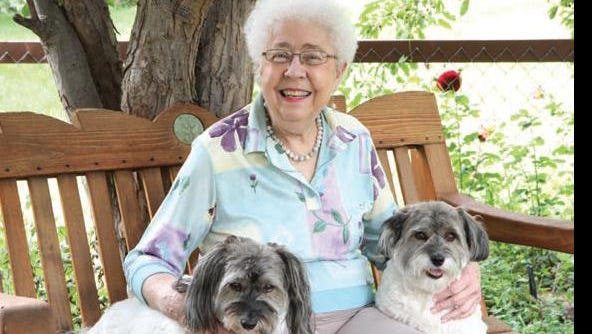 A busy lady beats cancer. Dona Ammons sits with her dogs, Mr. Beau Jangles and Bambi.
