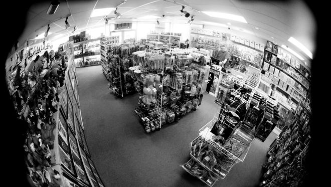 Stores like Excalibur Comics Cards & Games on East 70th Street utilize security cameras to catch shoplifters before they're out the door with stolen goods, keeping business owners from having to take theft cases to court.