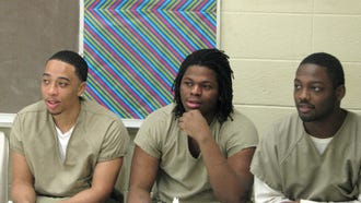 From left, Xavier Tate, Aurelius Canada and Romell Young listen to their instructor during a job interview exercise at the Cook County Jail in Chicago. The men are participants in the S.A.V.E. program, which includes intensive behavioral therapy and life skills training for about 50 detainees from some of Chicago's most violent neighborhoods. Jail officials are betting the program can help reduce gun violence in Chicago.