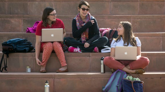 Theater, Film and Dance graduate students (from left) Haley Honeman, Ashley Laverty  and Rivka Rocchio chat while studying near the Hayden Library at ASU's Tempe campus in 2013.