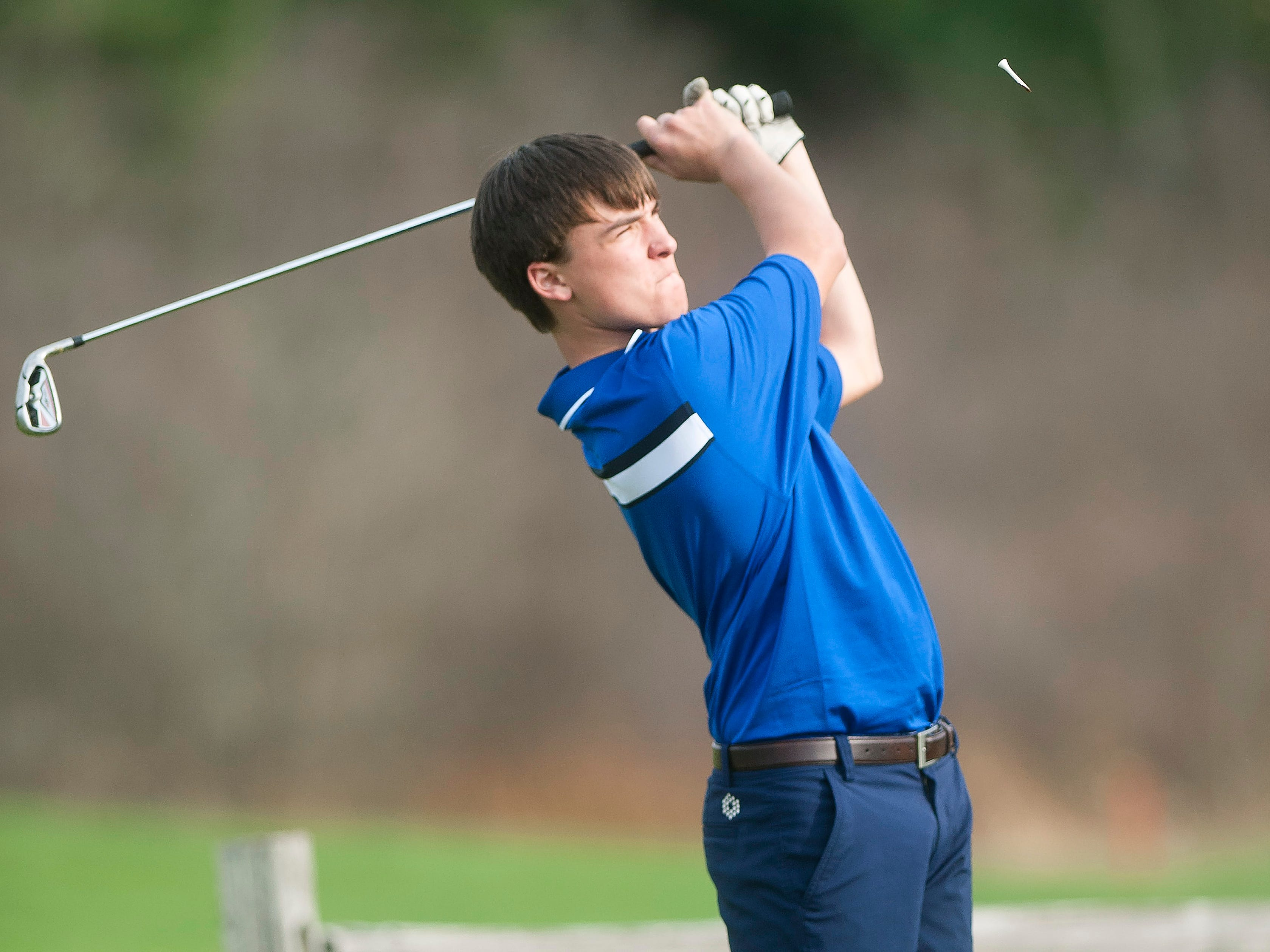 Mount Mansfield's Josh Graning tees off on the par-3 ninth hole at Essex Country Club during Tuesday's high school golf match.