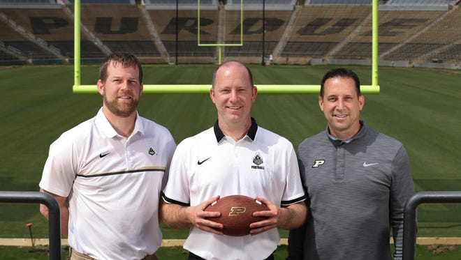 New Purdue Head Football Coach Jeff Brohm, center, is flanked by his brothers Brian Brohm, left, co-offensive coordinator/quarterbacks coach and Greg Brohm, executive director of administration and operations/chief of staff.  Jeff was formerly the head coach at Western Kentucky University and before that was offensive coordinator and assistant head coach at the University of Louisville.
