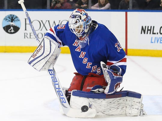 Rangers goalie Cam Talbot makes a save in the first period Sunday against the Carolina Hurricanes.