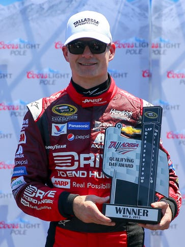Jeff Gordon poses with the pole award after qualifying