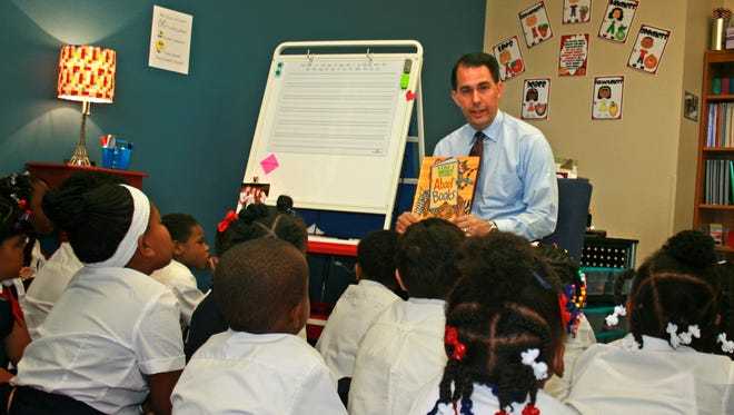 Gov. Scott Walker reads to first-graders at St. Marcus Lutheran, a voucher school, in 2012.