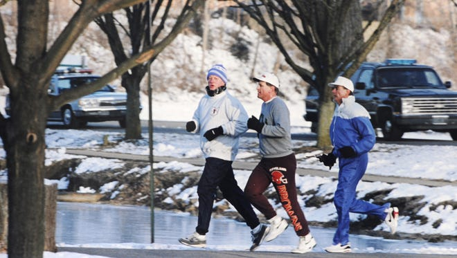 In this Chillicothe (Ohio) Gazette file photo, then-President Bill Clinton, left, jogs with Chillicothe Mayor Joe Sulzer and a Secret Service detail through Yoctangee Park the morning of Feb. 19, 1993.